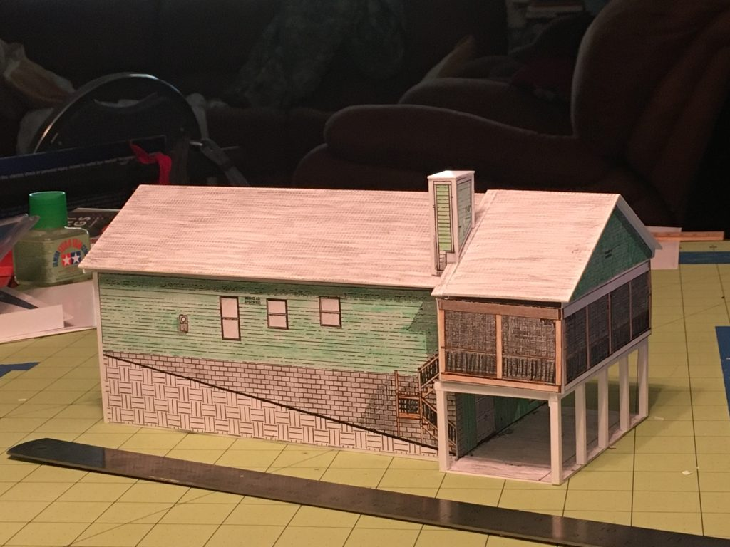 Model of driveway side of the house.