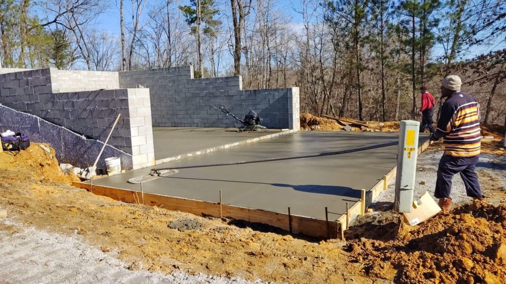 Concrete for the porch is poured & note the power pole has finally moved across the driveway!