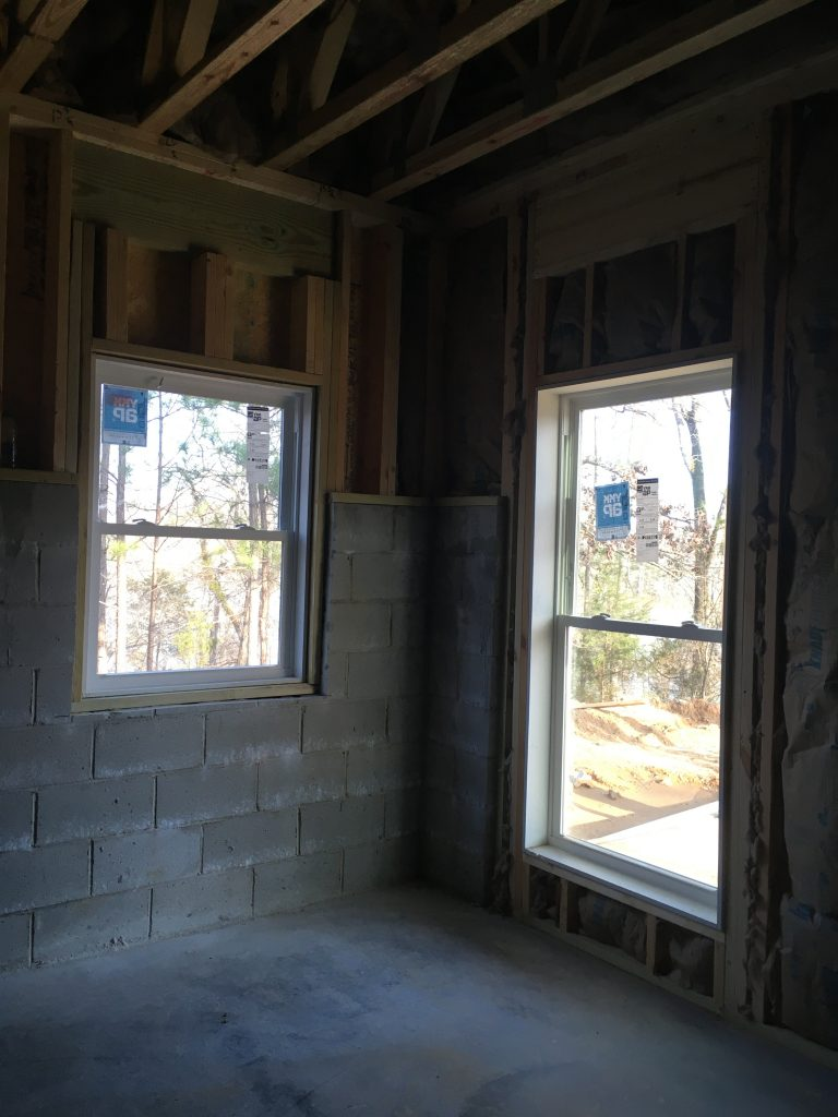 Original plans called for a larger window, but with the slope of the land we chose to switch to a smaller side window.
