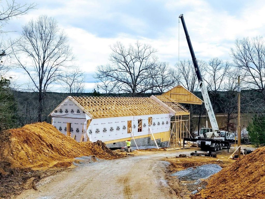 The last of the roof trusses is lifted into place.