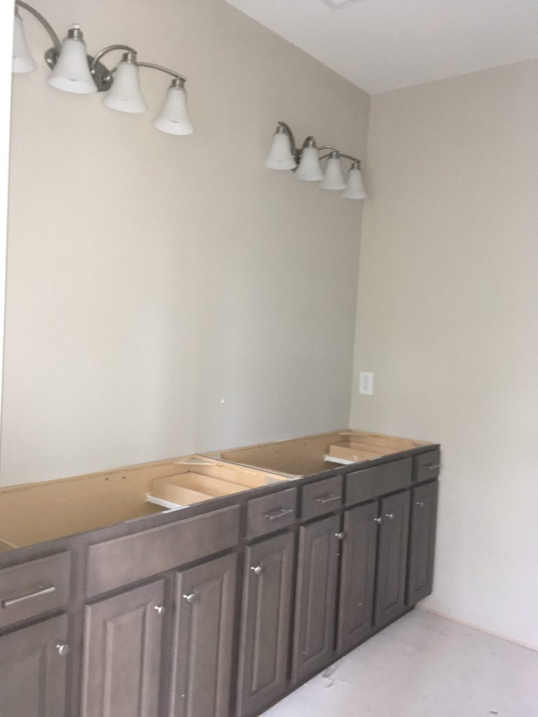 Cabinets and light fixtures installed.