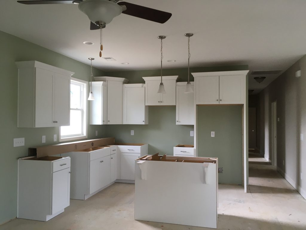 Kitchen cabinets and light fixtures installed.