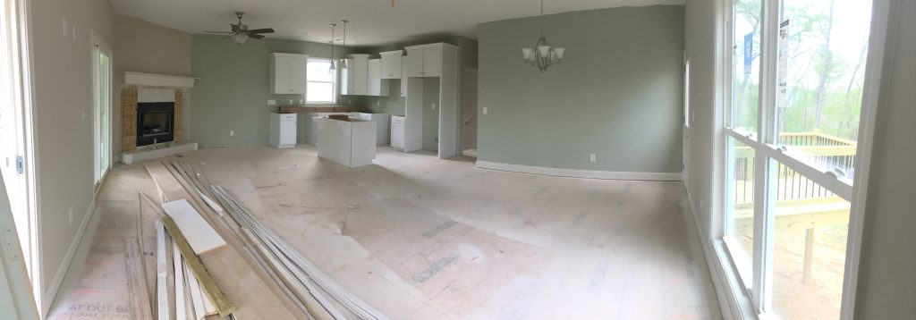Living area with cabinets and fixtures.