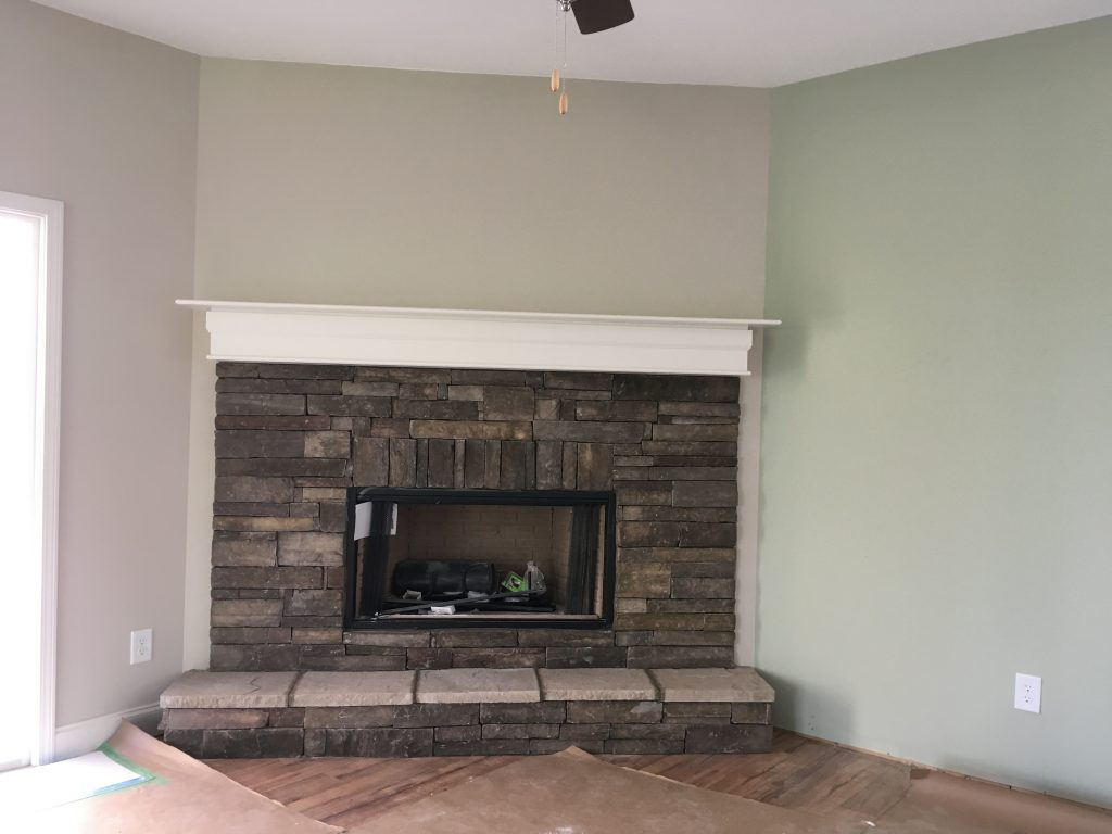 Stone fireplace in the corner of the living space.
