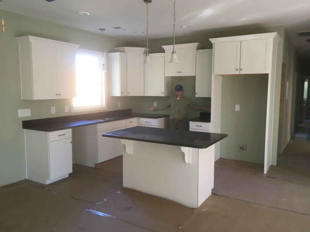 Kitchen counter tops are here. There was an error on the island's size. The cabinets were supposed to be 5' not 4'. The new ones are ordered.